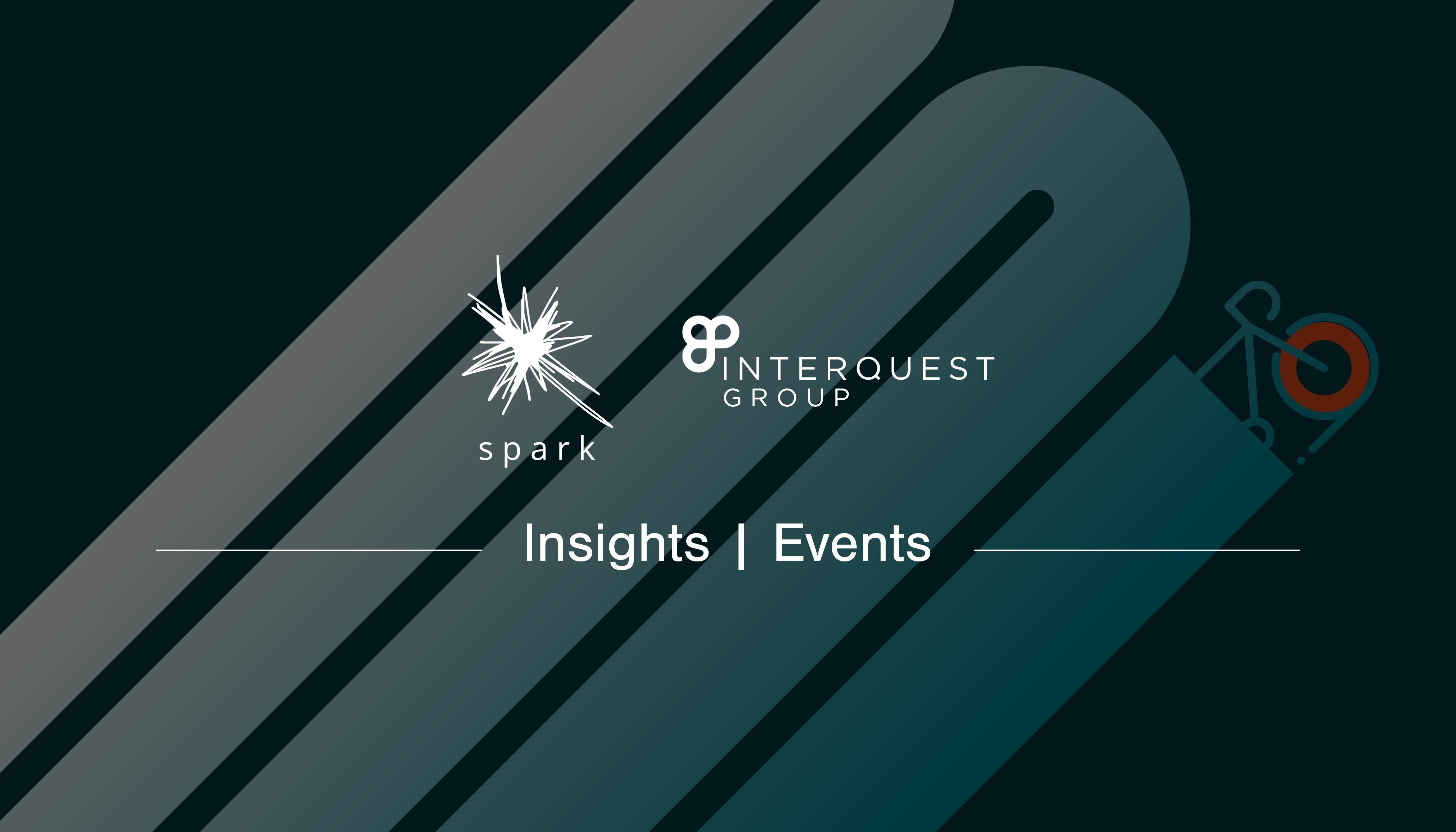 Event blog banner Spark and InterQuest Group logos in white on a graphic of a bicycle painting a route