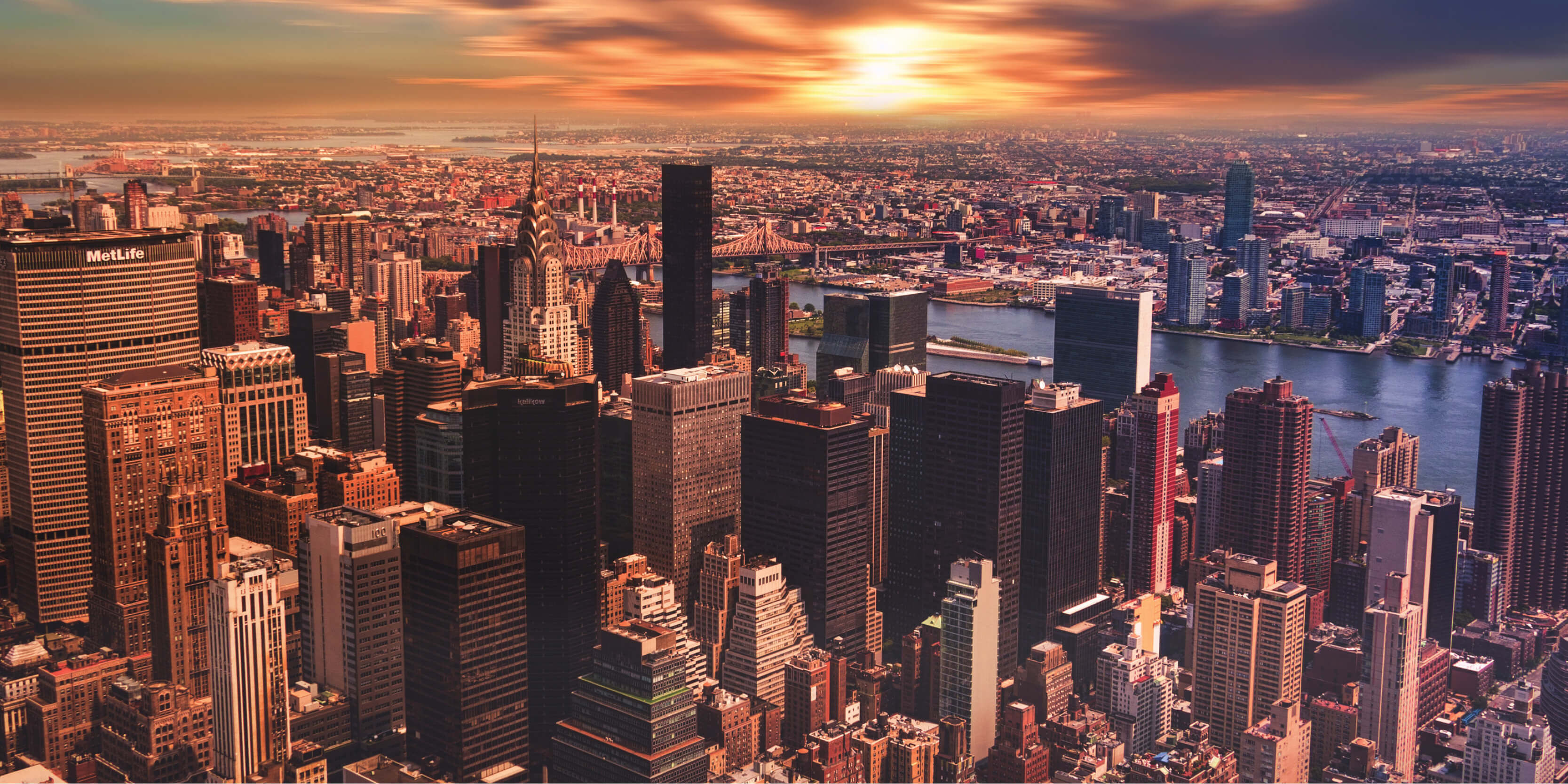 A photo of New York City skylines at sunset