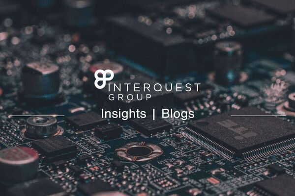 InterQuest Group blog header, close-up photo of a circuit-board as the background